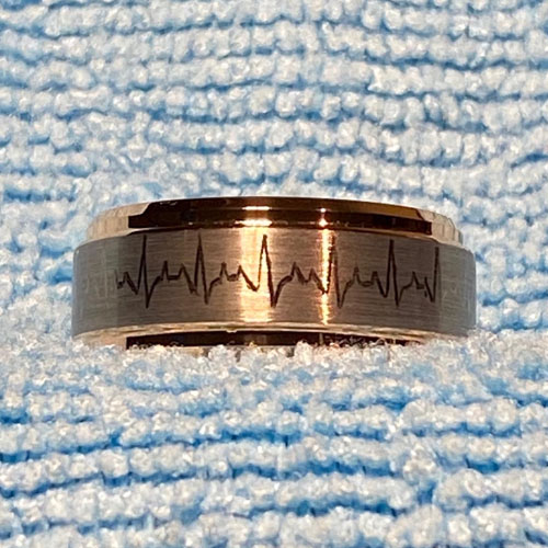 Tungsten carbide ring with hand engraved ECG pattern on the outside and initials on the inside
