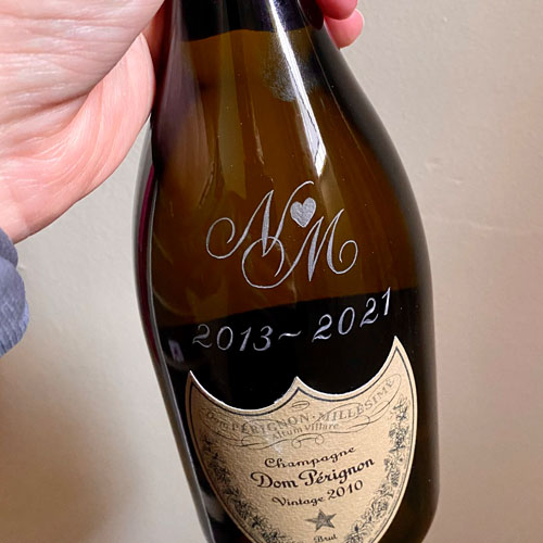 Hand engraved bottle of Perignon. This client has one each year in celebration of their wedding anniversary.