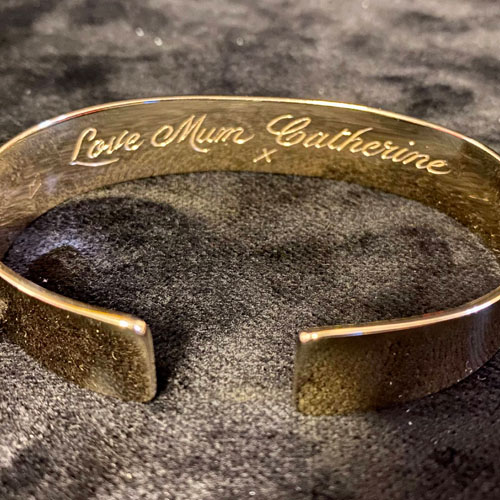 Hand engraved gold bangle