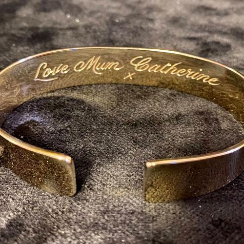 Hand engraved gold bangle