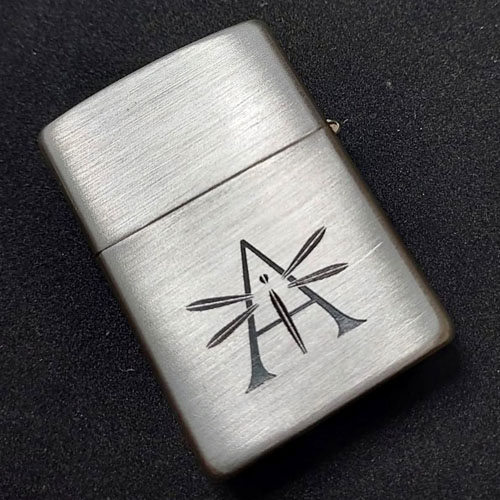 Solid silver Zippo with corporate branding front and reverse by machine