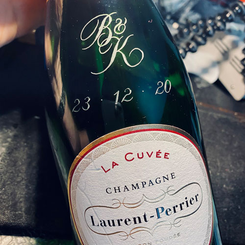 Hand engraved bottle of Champagne marking an engagement