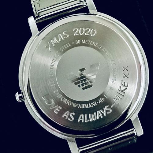 Machine engraved Armani watch case
