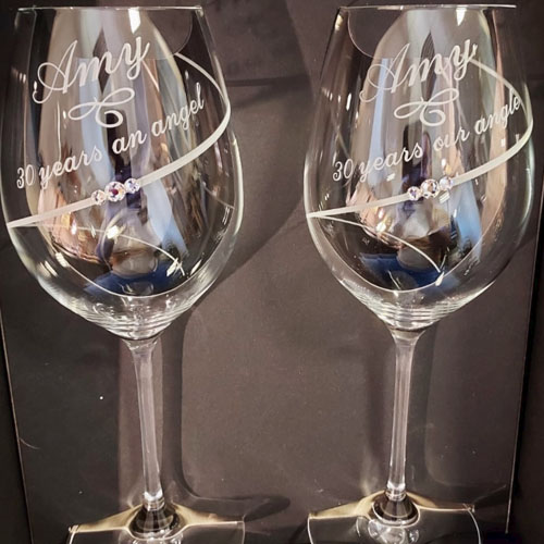 Machine engraved matching pair of crystal goblets